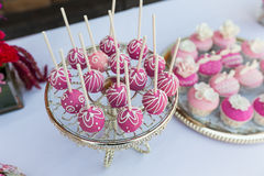 Cake pops and cupcakes. Wedding cake pops and cupcakes royalty free stock photo