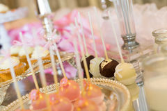 Cake pops and cupcakes Stock Images