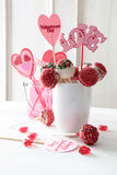 Cake pops with decorations on kitchen table Stock Image
