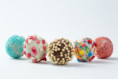 Cake pops isolated lying on white table. Beautiful cake pops isolated on white background Stock Image