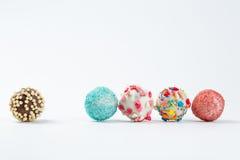 Cake pops isolated lying on white table. Beautiful cake pops isolated on white background Royalty Free Stock Photo