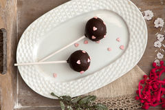 Cake pops. Little cakes on a stick covered with chocolate icing royalty free stock photography