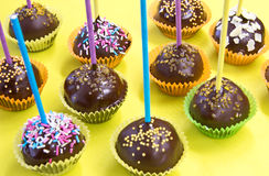 Cake pops over yellow Stock Images