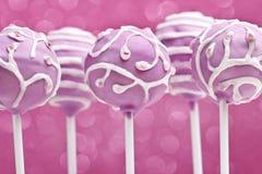Cake pops on pink background Stock Image