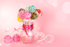 Cake pops with pink icing and decoration on paper form and color Stock Photo