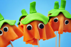 Cake pops with the shape of ghost Halloween pumpkins Royalty Free Stock Photo