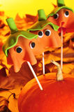 Cake pops with the shape of ghost Halloween pumpkins Royalty Free Stock Image