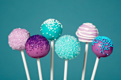Cake Pops. With sprinkles over a teal blue background Stock Photo