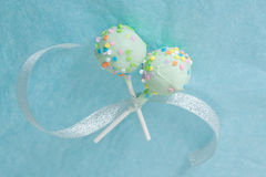 Cake Pops tied with a Ribbon. Two green cake pops with colorful sprinkles tied together with a silver ribbon Stock Photo