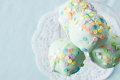 Cake Pops tied with a Ribbon. Two green cake pops with colorful sprinkles tied together with a silver ribbon Royalty Free Stock Photo