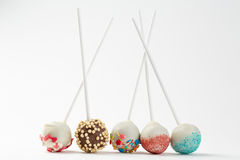 Cake pops  upside down on white table. Beautiful cake pops isolated on white background Stock Image