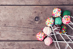 Cake pops on  vintage wooden background. Royalty Free Stock Photography