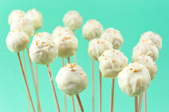 Cake pops. White cake pops with sprinkles on wooden sticks Stock Image