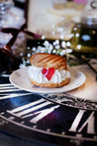 Cake profiteroles with cream and marmalade heart Royalty Free Stock Photography