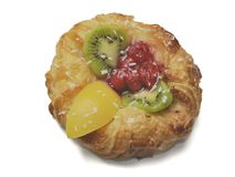 Cake from puff pastry with fresh fruit a kiwi, raspberry, a peach on a white background royalty free stock image