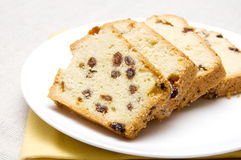 Cake with raisins. Slices of cake with raisins arranged on a white plate Stock Photo