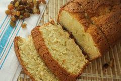 Cake with raisins. Baking cake with raisins on blue background Royalty Free Stock Image