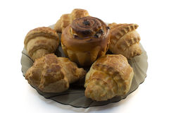 cake with raisins and croissants on dark brown plate. Stock Photo