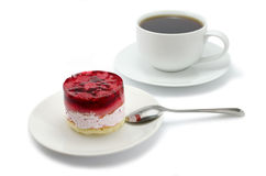 Cake with raspberries and a cup of tea royalty free stock photography