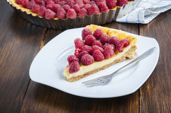 Cake with raspberries. Homemade tart with raspberries and fork Stock Photos