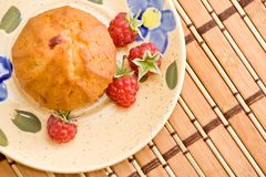 Cake with raspberry. A cake with raspberry is lie on the plate Royalty Free Stock Photo