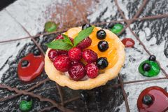 Cake with raspberry and currant. Sweet dessert cake with raspberry and currant fruit on a plate Royalty Free Stock Photo