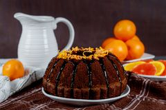 Cake is ready. Bundt cake with chocolate glaze. And orange pound frosting dessert sweet dark pastry bakery homemade brown sponge delicious sugar baked pie tasty royalty free stock photos