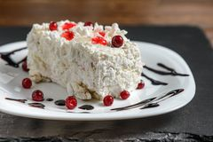 Cake with red berries on white plate Stock Photos