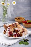 Cake with red and black currant berries. On the table. Rustic style stock photography