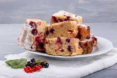 Cake with red and black currant berries. On the table. Rustic style stock image