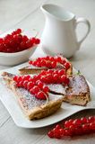 Cake with red currant. Dessert with red currant and a jug of milk Royalty Free Stock Photo
