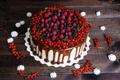 Cake with red currants, raspberries and blackberries Stock Image