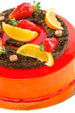 Cake red glaze with strawberry and orange slices. Royalty Free Stock Photography