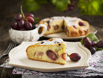 Cake with red grapes Royalty Free Stock Images