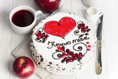 Cake with a red heart and pattern. Delicious cake with a red heart and pattern on a light background royalty free stock photo