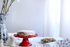 Cake on a red stocking and on a white background. Bouquet of flowers. Free space for text. stock photography