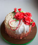 Cake with red sugar roses Stock Images