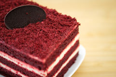 Cake. Red velvet cake and white cream on wooden table, close up, space to write royalty free stock image