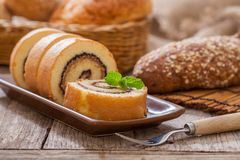 Cake roll and bread stock images