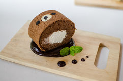 Cake roll. Chocolate roll cake on wood plate royalty free stock images