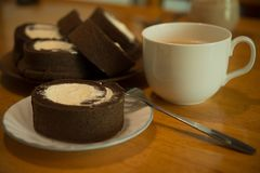 Cake roll. Homemade cocoa cake roll with full cream royalty free stock images
