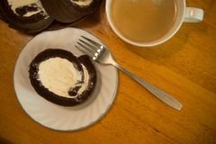 Cake roll. Homemade cocoa cake roll with full cream stock photo