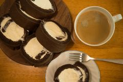 Cake roll. Homemade cocoa cake roll with full cream royalty free stock photos