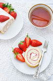 Cake roll with strawberries and cream cheese. On a white background. tinting. selective focus royalty free stock photos