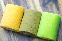 Cake roll on wooden table. Fresh cake roll on wooden table Royalty Free Stock Images