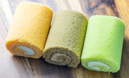 Cake roll on wooden table. Fresh cake roll on wooden table Stock Photos