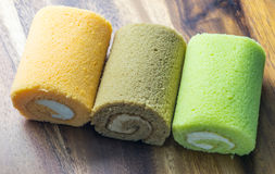 Cake roll on wooden table. Fresh cake roll on wooden table Stock Photo