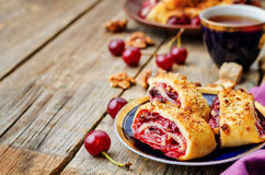Cake rolls with cherry and walnut crust. The toning. selective focus stock photos
