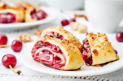 Cake rolls with cherry and walnut crust Royalty Free Stock Image