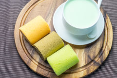 Cake rolls on wooden plate Royalty Free Stock Photo
